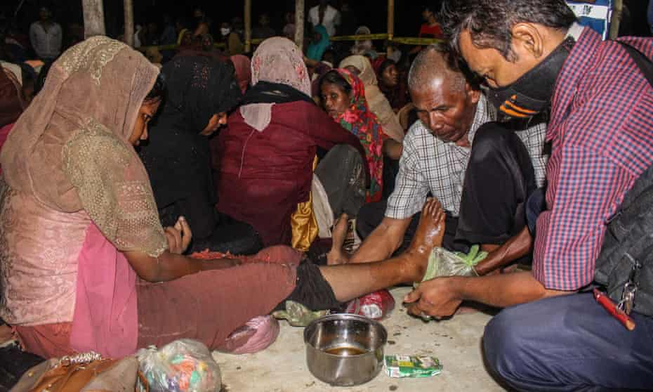 A Rohingya woman is treated on 7 September after landing on Ujong Blang beach, Indonesia