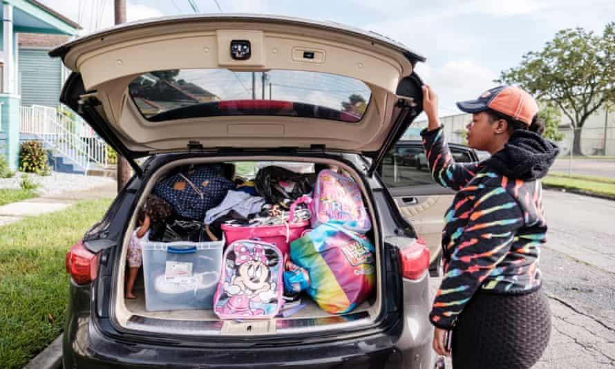 Jerica Washington packs her vehicle full as she prepares to evacuate to Texas before the arrival of Hurricane Ida in New Orleans, Louisiana.