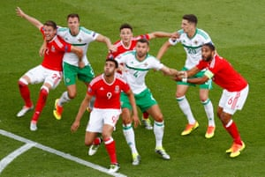 Wales' Ashley Williams, James Chester, Hal Robson-Kanu and Chris Gunter wait for the ball to arrive in the area along with with Northern Ireland's Jonny Evans, Gareth McAuley and Craig Cathcart. Wales won the last-16 tussle 1-0