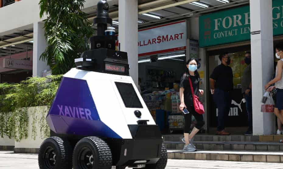 """An autonomous robot named """"Xavier"""" patrols a shopping and residential district during a three-week trial by the Home Team Science and Technology Agency (HTX) in Singapore."""