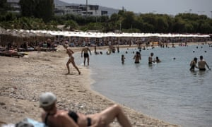 Swimmers enjoy the sea and the sun at Alimos beach, near Athens, on Saturday 16 May. (AP Photo/Yorgos Karahalis, File)