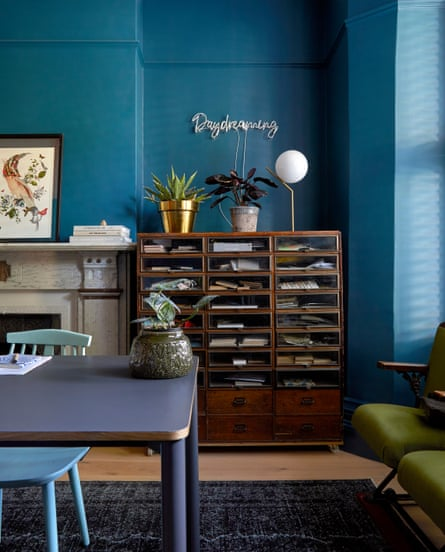 In Toong's study are a vintage haberdashery cabinet, a table from made.com, a painted eBay chair, and an artwork by Kristjana S Williams. The walls are 50BG 10/175 by Dulux Trade