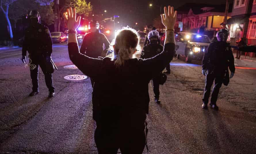 A demonstrator confronts a line of police officers in Oakland, California, on 16 April.