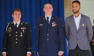 U.S. Army Specialist Alek Skarlatos, Airman 1st Class Spencer Stone, and Anthony Sadler attend an awards ceremony at the Pentagon September 17, 2015 in Arlington, Virginia.