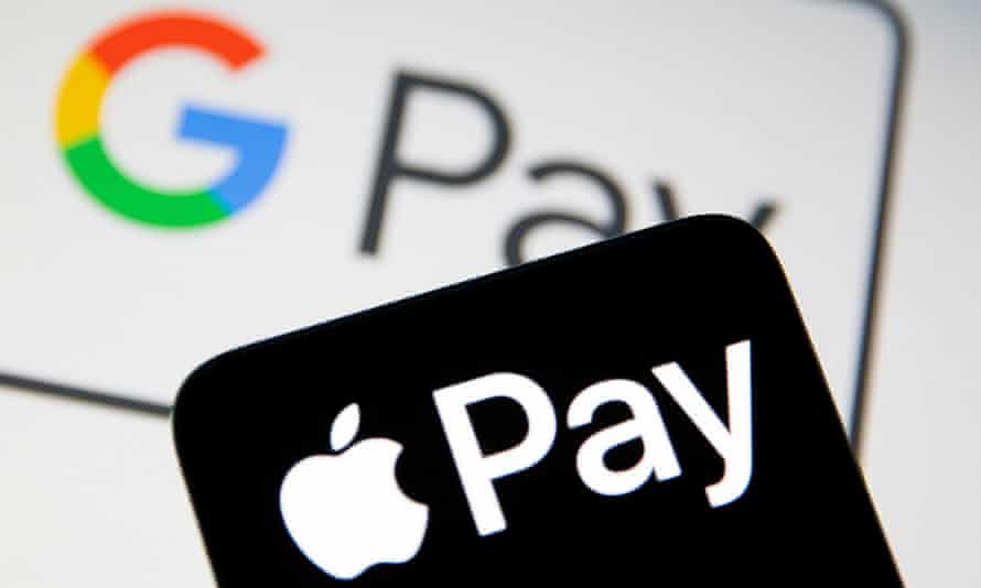 A smartphone with the Apple Pay logo is placed on a displayed Google Pay logo