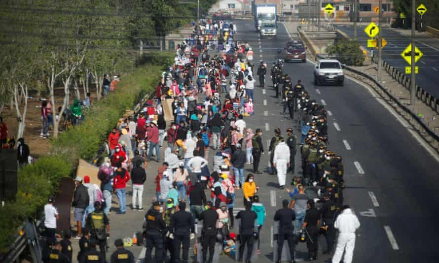 Peruvians are stopped by riot police in Lima as they try to make their way to San Martin and other parts of the country on 18 April.