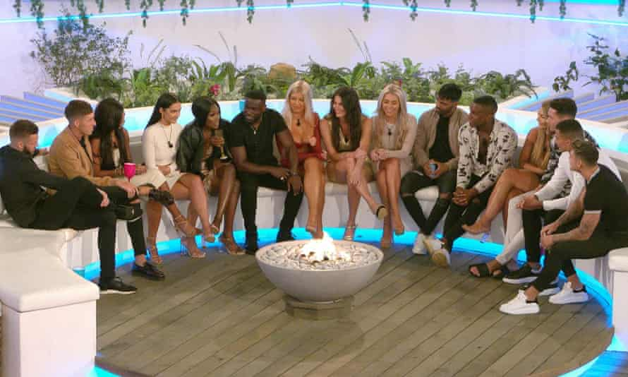 Contestants gather around the fire pit at the start of series six of Love Island