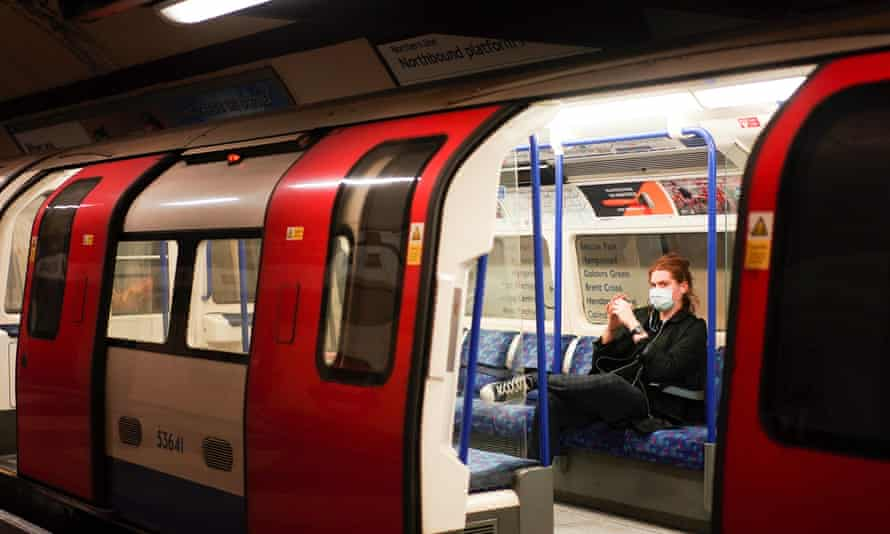 A person wearing a face mask on the London underground on 15 March.