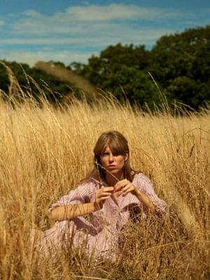 Striped maxi dress, £295, seraphinalondon.com. Drop earrings, £250, shop.alighieri.co.uk