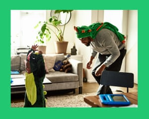 Young boy being chased by dad in fancy dress costume at home, carefree, fun, childhood