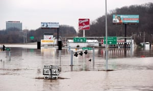 Flood waters from the nearby Meramec River fill the traffic lanes of I-44 and Missouri Route 141 near Valley Park, Missouri, just west of St Louis, on Wednesday.