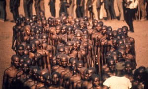 In Biafra, in 1968, Cagnoni made what many consider his most iconic image: a group of 150 young, bare-chested, shaven-headed Igbo soldiers gathered in the harsh sunlight.