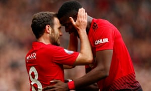 Juan Mata is congratulated by Paul Pogba after scoring United's goal