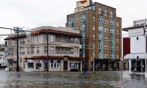 The intersection of 8th Street and Atlantic Avenue is flooded in Ocean City, N.J., after the storm surge from Superstorm Sandy flooded much of the town, aided by rising sea levels.