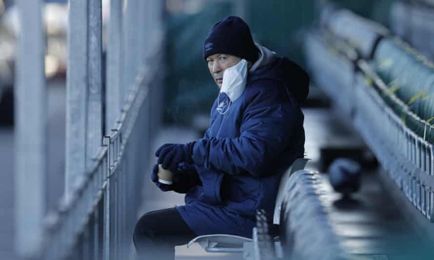 Eddie Jones, the England head coach, looks on during the match between Ealing Trailfinders and Saracens.