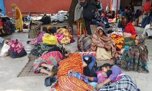 Families wait for treatment outside the All India Institute of Medical Sciences