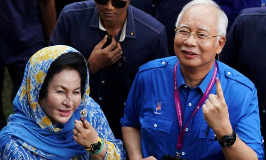 Najib Razak and his wife Rosmah Mansor show their ink-stained fingers after voting in Malaysia's general election in 2018