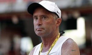 Alberto Salazar watches a training session at the world athletic championships