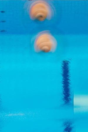 Daniel Goodfellow and Jack Laugher of Great Britain in a spin during the men's 3m springboard final.