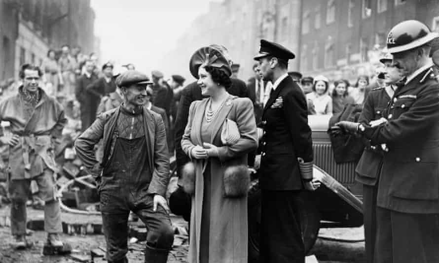 George VI and Queen Elizabeth survey the damage of an air raid in 1940