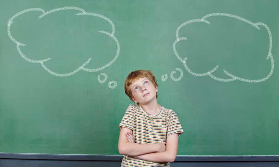 Child in front of blackboard