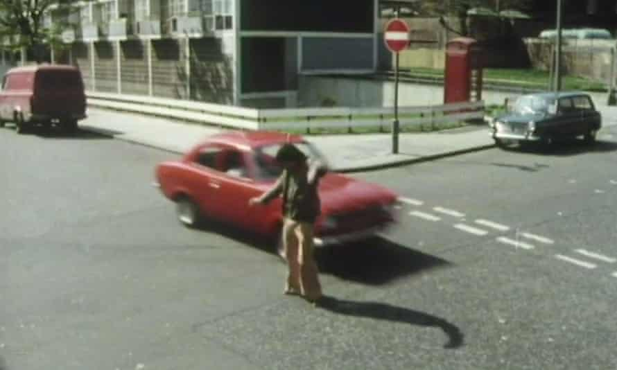 Fred Mumford narrowly avoids a speeding car in the opening scene of Rentaghost