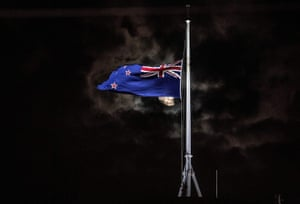 New Zealand's national flag flies at half-mast on a parliament building in Wellington
