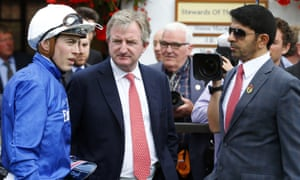 James Doyle, left, with trainer Saeed bin-Suroor, right, and John Ferguson at Newmarket last summer.