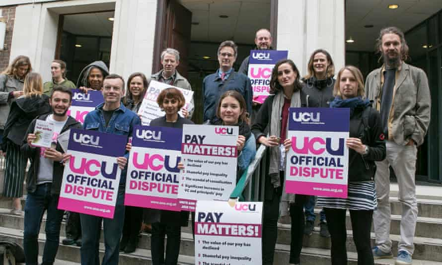Protesting University College Union members holding placards
