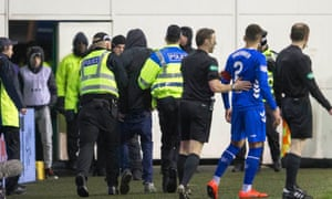 James Tavernier of Rangers is pulled away from a Hibernian fan who ran on to the pitch during last month's Scottish Premiership match at Easter Road.