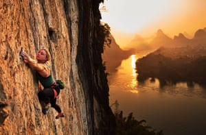 Sport, story, first prize: Adam Pretty, Amy Dunlop of Australia reaches for a small crimper while climbing 'The Dentist 5.12b' at sunrise in Yangshuo near Guilin, China