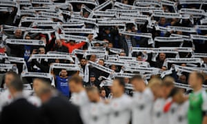 Fans show their love and respect for Vichai Srivaddhanaprabha during a two minute silence or before the match against Burnley.