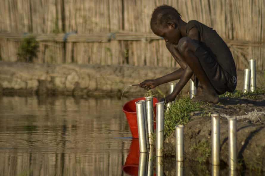 A child fetches water in Jonglei state