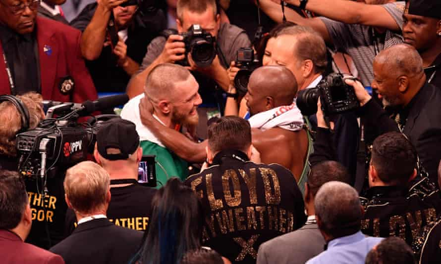 Floyd Mayweather and Conor McGregor embrace following their fight