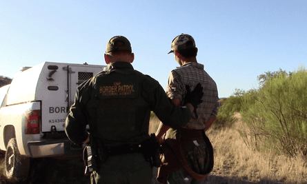 Border Patrol officers arresting migrants at the camp. No More Deaths described the raid as 'a very troubling development'.