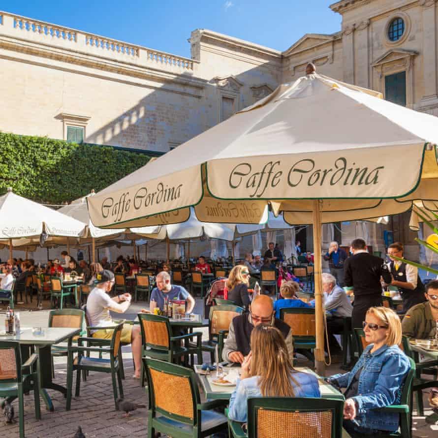 Tourists at Cafe Cordina, Valletta, Malta.