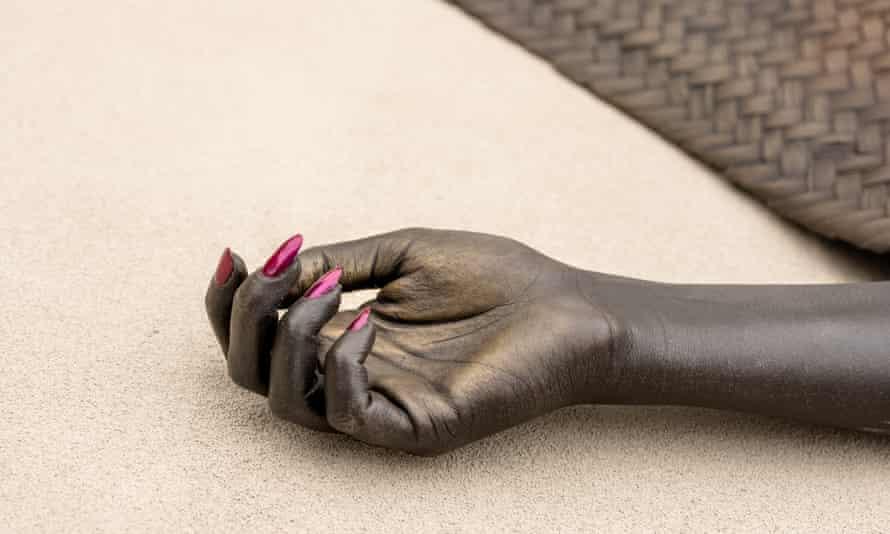 Shavasana I and Shavasana II are bronze figures of black women under woven yoga mats.