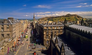 VIEW DOWN THE ROYAL MILE AND ALONG THE HIGH STREET WITH SALISBURY CRAGS AND ARTHUR'S SEAT IN THE DISTANCE FROM THE ROOF OF ST GILES CATHEDRAL (NO ACCESS TO THE PUBLIC), EDINBURGH. PIC: P TOMKINS/VISITSCOTLAND