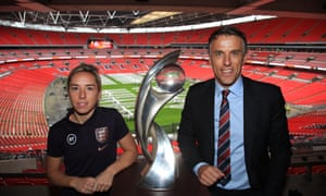 Jordan Nobbs and Phil Neville are pictured with the trophy at Wembley, where the Women's Euro 2022 final is still scheduled to take place.