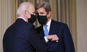 Joe Biden greets John Kerry, the administration's climate envoy.