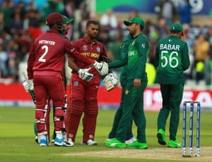 Nicholas Pooran (centre) and Shimron Hetmyer commiserate with the Pakistan players after the Windies' emphatic victory.
