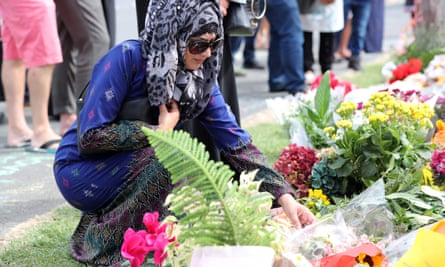 Mourners in Auckland place flowers at their local mosque for the victims of the shooting attacks in Christchurch.