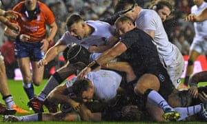 Ellis Genge squeezes over the line in filthy conditions at Murrayfield to score a try for England.