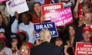 Donald Trump faces the crowd at a rally in Pensacola, Florida for US midterm elections