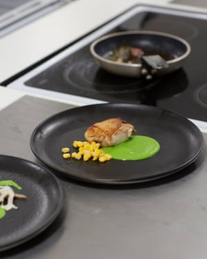 Well-presented dish on a black plate