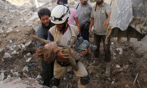 TOPSHOT-SYRIA-CONFLICT-ALEPPO<br>TOPSHOT - A Syrian civil defence volunteer, known as the White Helmets, holds the body of a child after he was pulled from the rubble following a government forces air strike on the rebel-held neighbourhood of Karm Homad in the northern city of Aleppo, on October 4, 2016. Syrian regime forces advanced against rebels during intense street battles in the heart of Aleppo, after the United States abandoned talks with Russia aimed at reviving a ceasefire deal.  / AFP / AMEER ALHALBI        (Photo credit should read AMEER ALHALBI/AFP via Getty Images)