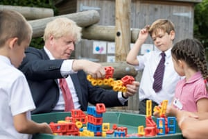 Britain's Prime Minister Boris Johnson plays with toys as students look on during a visit to The Discovery School in Kent, Britain on 20 July, 2020.