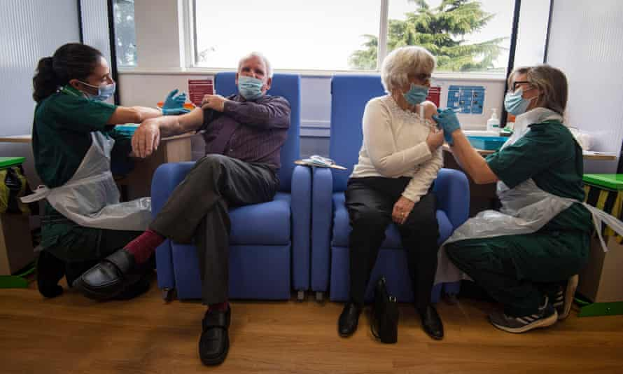 Patients receive the Pfizer/BioNTech Covid-19 vaccine at Basildon University hospital, Essex, December 2020