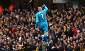 Watford goalkeeper Heurelho Gomes celebrates after Etienne Capoue (not pictured) scores his side's first goal of the game.