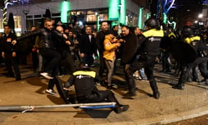 Riot police clash with demonstrators in the streets near the Turkish consulate in Rotterdam in the early hours of Sunday.